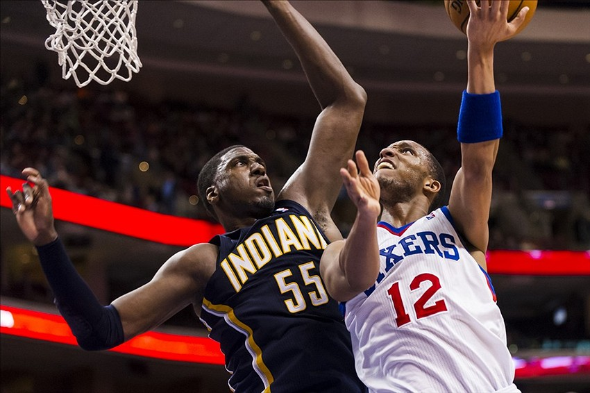 Mar 16, 2013; Philadelphia, PA, USA; Philadelphia 76ers guard Evan Turner (12) shoots under pressure from Indiana Pacers center Roy Hibbert (55) during the fourth quarter at the Wells Fargo Center. The Sixers defeated the Pacers 98-91. Mandatory Credit: Howard Smith-USA TODAY Sports