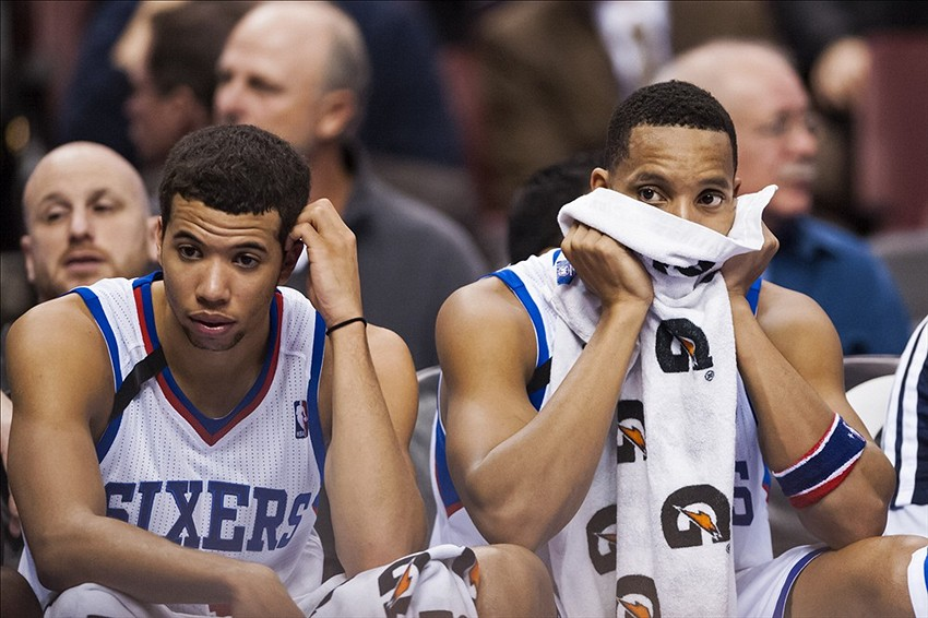 Nov 11, 2013; Philadelphia, PA, USA; Philadelphia 76ers guard Michael Carter-Williams (1) and guard Evan Turner (12) watch from the bench late in the fourth quarter against the San Antonio Spurs at Wells Fargo Center. The Spurs defeated the Sixers 109-85. Mandatory Credit: Howard Smith-USA TODAY Sports