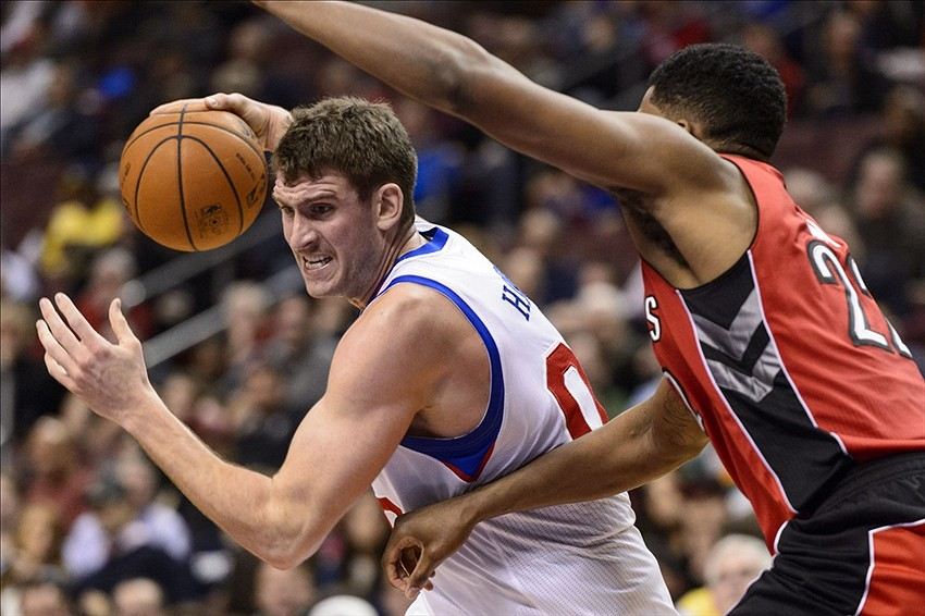 Nov 20, 2013; Philadelphia, PA, USA; Philadelphia 76ers center Spencer Hawes (00) is defended by Toronto Raptors forward Rudy Gay (22) during the fourth quarter at Wells Fargo Center. The Raptors defeated the Sixers 108-98. Mandatory Credit: Howard Smith-USA TODAY Sports