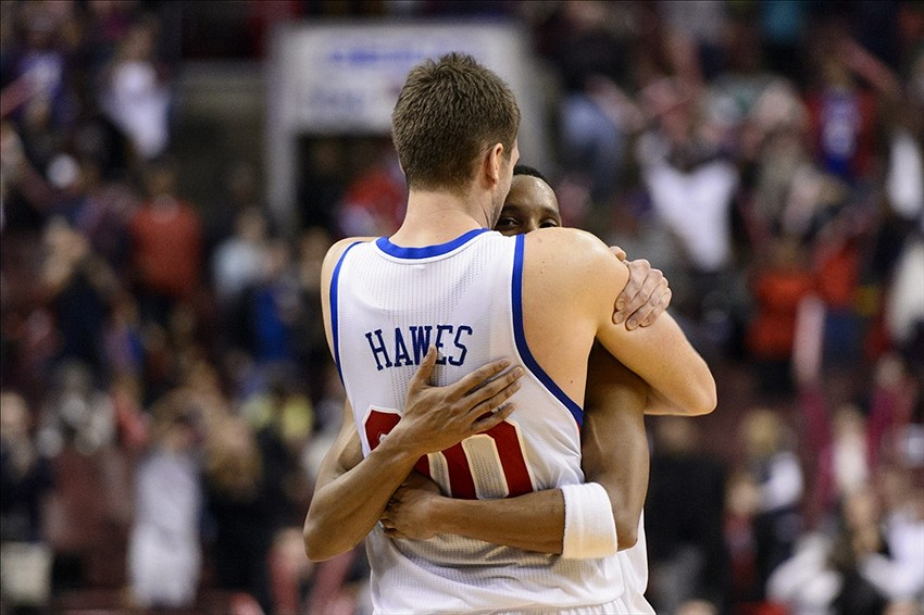 Nov 22, 2013; Philadelphia, PA, USA; Philadelphia 76ers center Spencer Hawes (00) and guard Evan Turner (12) hug as time expires in overtime against the Milwaukee Bucks at Wells Fargo Center. The Sixers defeated the Bucks 115-107 in overtime. Mandatory Credit: Howard Smith-USA TODAY Sports