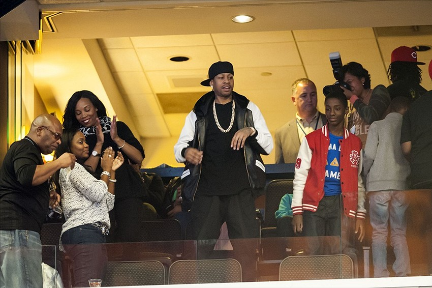 Oct 30, 2013; Philadelphia, PA, USA; Retired members of the Philadelphia 76ers Allen Iverson watches a video tribute to his career at the end of the first quarter of a game against the Miami Heat at Wells Fargo Center. Mandatory Credit: Howard Smith-USA TODAY Sports