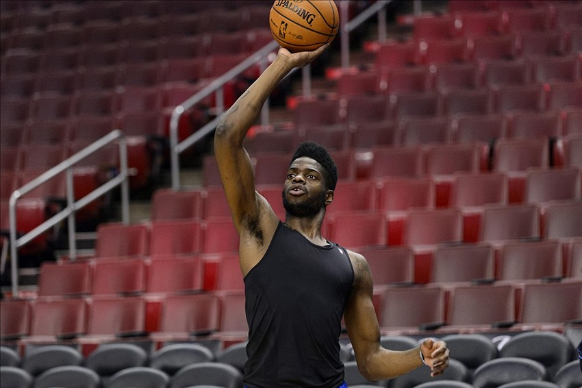 Dec 14, 2013; Philadelphia, PA, USA; Philadelphia 76ers center Nerlens Noel (4) shoots baskets during warmups prior to the game against the Portland Trail Blazers at the Wells Fargo Center. Mandatory Credit: Howard Smith-USA TODAY Sports