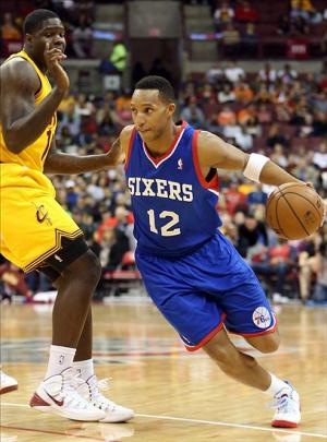 Oct 21, 2013; Columbus, OH, USA; Philadelphia 76ers shooting guard Evan Turner (12) drives around Cleveland Cavaliers power forward Anthony Bennett (15) during the first quarter at Schottenstein Center. Mandatory Credit: Ron Schwane-USA TODAY Sports