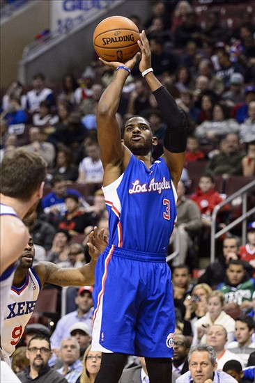 Dec 9, 2013; Philadelphia, PA, USA; Los Angeles Clippers guard Chris Paul (3) shoots a jump shot during the first quarter against the Philadelphia 76ers at the Wells Fargo Center. Mandatory Credit: Howard Smith-USA TODAY Sports