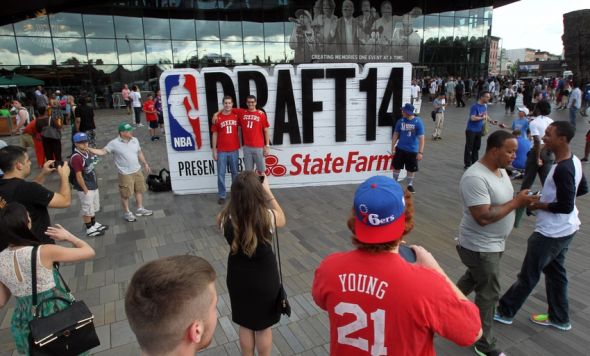 Jun 26, 2014; Brooklyn, NY, USA; Philadelphia 76ers fans pose in front of a sculpture before the 2014 NBA Draft at the Barclays Center. Mandatory Credit: Brad Penner-USA TODAY Sports
