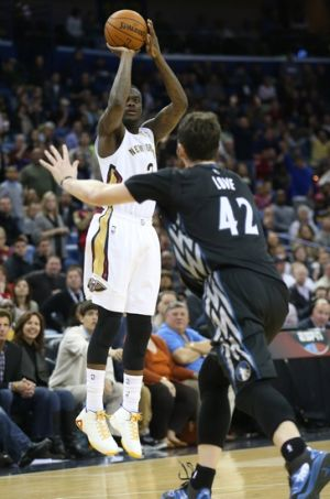 Feb 7, 2014; New Orleans, LA, USA; New Orleans Pelicans shooting guard Anthony Morrow (3) shoots the ball over Minnesota Timberwolves power forward Kevin Love (42) in the second half at the Smoothie King Center. The Pelicans won 98-91. Mandatory Credit: Crystal LoGiudice-USA TODAY Sports