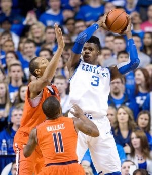 Feb 9, 2013; Lexington, KY, USA; Kentucky Wildcats forward Nerlens Noel (3) rebounds the ball against Auburn Tigers guard Josh Wallace (11) and center Asauhn Dixon-Tatum (0) in the second half of the game at Rupp Arena. Kentucky defeated Auburn 72-62. Mandatory Credit: Mark Zerof-USA TODAY Sports