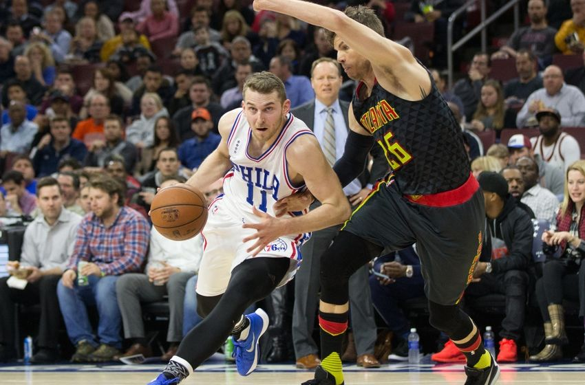 Feb 3, 2016; Philadelphia, PA, USA; Philadelphia 76ers guard Nik Stauskas (11) dribbles past Atlanta Hawks guard <a rel=