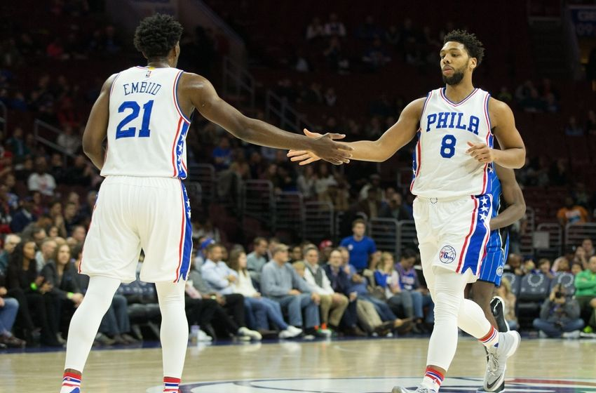 Dec 2, 2016; Philadelphia, PA, USA; Philadelphia 76ers center Joel Embiid (21) and center Jahlil Okafor (8) congratulate each other after a score against the Orlando Magic during the second quarter at Wells Fargo Center. Mandatory Credit: Bill Streicher-USA TODAY Sports