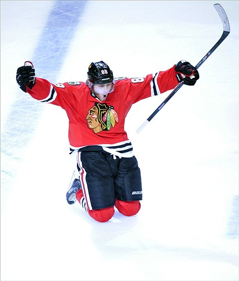 Jun 8, 2013; Chicago, IL, USA; Chicago Blackhawks right wing Patrick Kane (88) celebrates after scoring the game-winning goal during the second overtime in game five of the Western Conference finals of the 2013 Stanley Cup Playoffs against the Los Angeles Kings at the United Center. The Blackhawks won 4-3 to win the series four games to one. Mandatory Credit: Scott Stewart-USA TODAY Sports