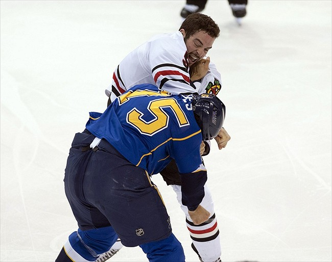 Mar 6, 2012; St. Louis, MO, USA; St. Louis Blues right wing Ryan Reaves (75) fights with Chicago Blackhawks left wing Brandon Bollig (52) during the first period at Scottrade Center. Mandatory Credit: Ed Szczepanski-USA TODAY Sports