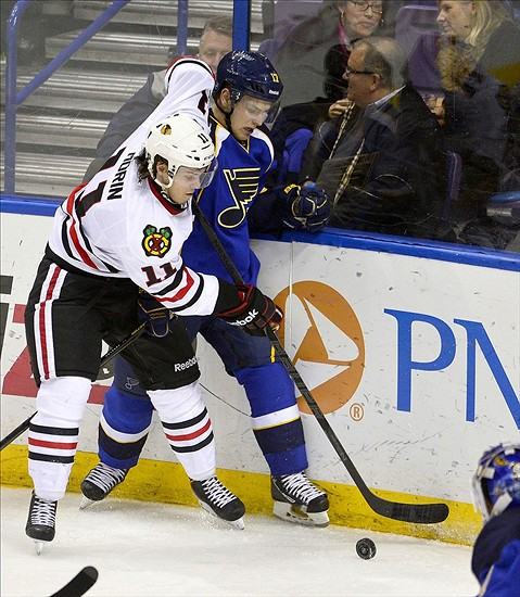 Apr 27, 2013; St. Louis, MO, USA; Chicago Blackhawks left wing Jeremy Morin (11) checks St. Louis Blues center Vladimir Sobotka (17) during the third period at the Scottrade Center. The Blues defeated the Blackhawks 3-1. Mandatory Credit: Scott Rovak-USA TODAY Sports