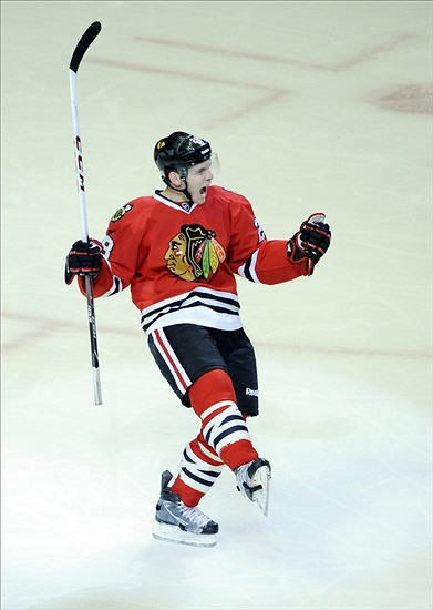 Oct 12, 2013; Chicago, IL, USA; Chicago Blackhawks right wing Ben Smith (28) celebrates his goal against the Buffalo Sabres during the first period at the United Center. Mandatory Credit: David Banks-USA TODAY Sports
