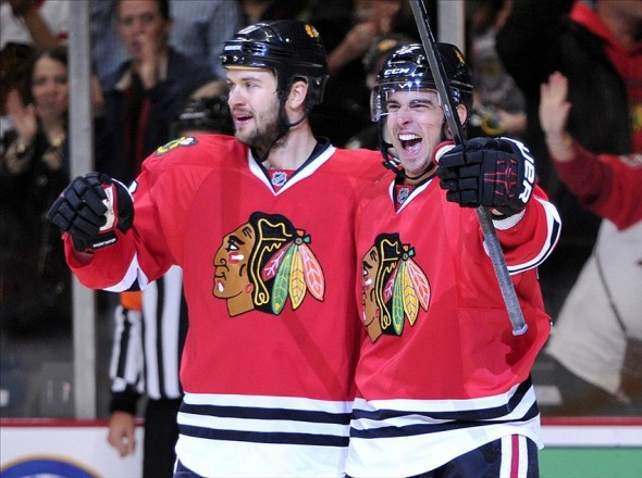 Oct 19, 2013; Chicago, IL, USA; Chicago Blackhawks center Brandon Pirri (right) celebrates scoring a goal with defenseman Brent Seabrook (left) against the Toronto Maple Leafs during the second period at the United Center. Mandatory Credit: Rob Grabowski-USA TODAY Sports