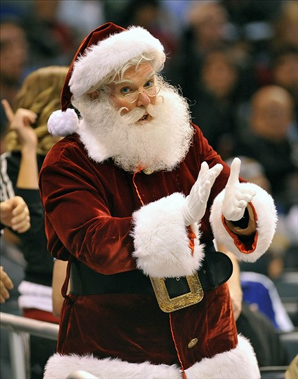 December 23, 2012; Orlando, FL, USA; Santa Claus cheers in the first half of the game between the Orlando Magic and the Utah Jazz at Amway Arena. Mandatory Credit: Brad Barr-USA TODAY Sports