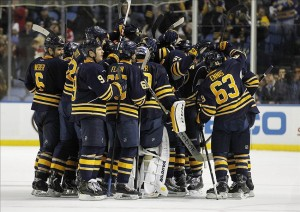 Nov 29, 2013; Buffalo, NY, USA; The Buffalo Sabres mob defenseman Christian Ehrhoff (10) after he scored the winning goal in OT on the Toronto Maple Leafs at First Niagara Center. Sabres beat the Leafs 3-2 in OT. Mandatory Credit: Kevin Hoffman-USA TODAY Sports