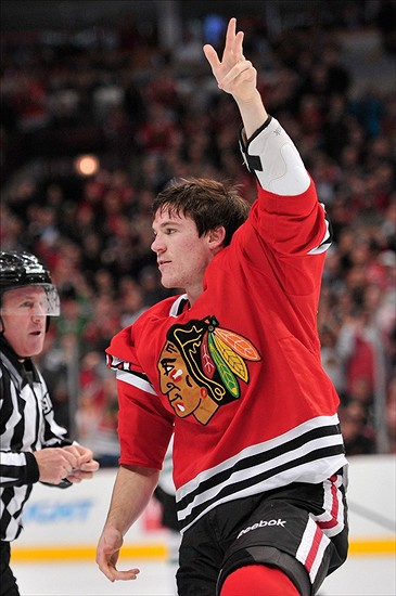 Dec 3, 2013; Chicago, IL, USA; Chicago Blackhawks center Andrew Shaw (65) gestures to the fans after a fight with Dallas Stars left wing Antoine Roussel (not pictured) during the first period at the United Center. Mandatory Credit: Rob Grabowski-USA TODAY Sports