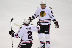 Dec 17, 2013; Nashville, TN, USA; Chicago Blackhawks defenseman Duncan Keith (2) and Blackhawks right wing Marian Hossa (81) celebrate a goal by Keith during the first period at Bridgestone Arena. Mandatory Credit: Mike Strasinger-USA TODAY Sports