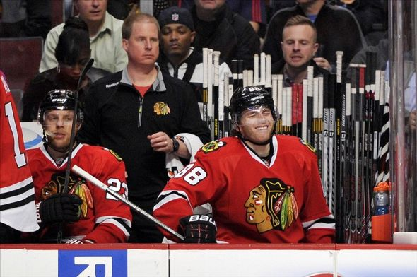 Mar 19, 2014; Chicago, IL, USA; Chicago Blackhawks right wing Patrick Kane (88) sits on the bench after being injured against the St. Louis Blues during the second period at the United Center. Mandatory Credit: Rob Grabowski-USA TODAY Sports