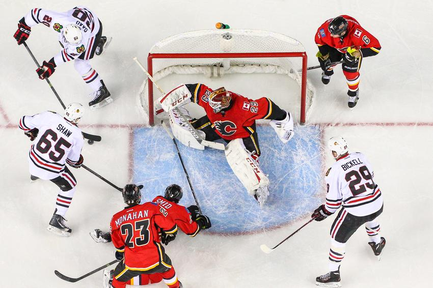 Chicago Blackhawks left wing Brandon Saad (20), center Andrew Shaw (65), and left wing Bryan Bickell (29) try to score.
