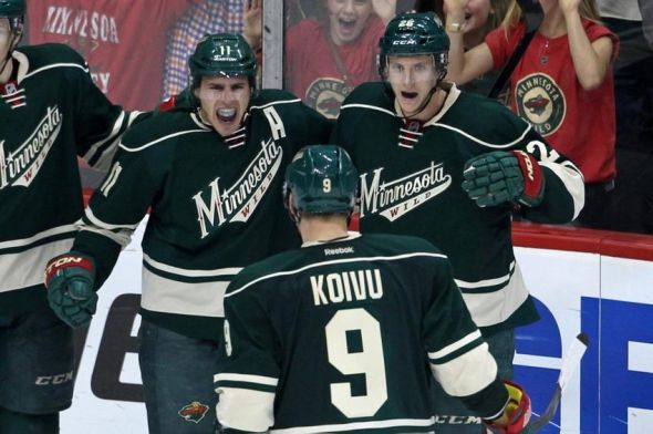 Apr 28, 2014; Saint Paul, MN, USA; Minnesota Wild forward Zach Parise (11) celebrates his goal with forward Mikko Koivu (9) during the third period against the Colorado Avalanche in game six of the first round of the 2014 Stanley Cup Playoffs at Xcel Energy Center. The Wild defeated the Avalanche 5-2. Mandatory Credit: Brace Hemmelgarn-USA TODAY Sports