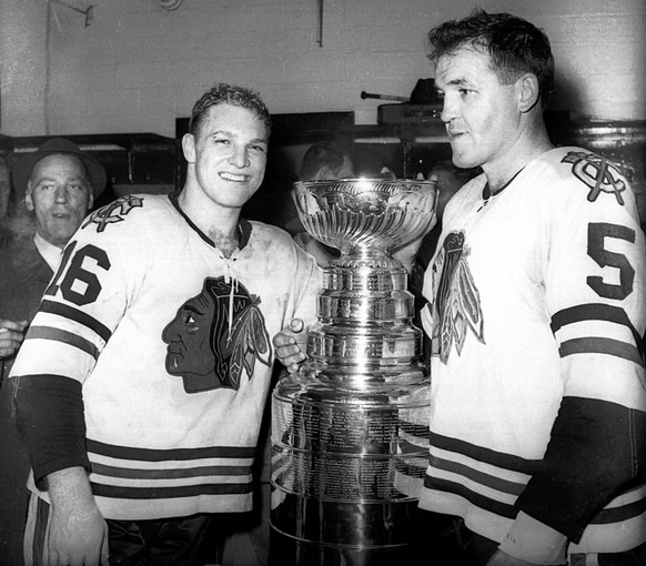 Bobby Hull (Left) and Jack Evans (Right) take a picture with their newly acquired Stanley Cup in 1961. (Photo courtesy of greatesthockeylegends.com)