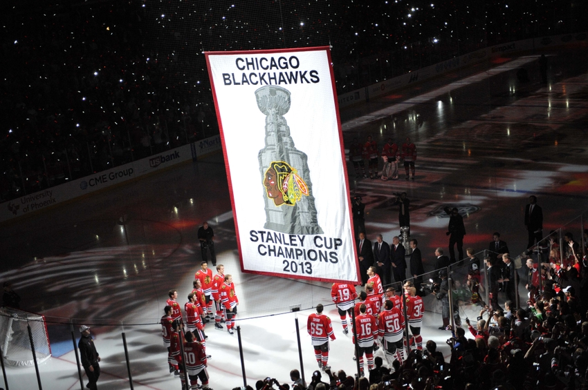 Oct 1, 2013; Chicago, IL, USA; Members of the Chicago Blackhawks watch as the 2013 Stanley Cup championship banner is raised to the rafters before the game against the Washington Capitals at the United Center. Mandatory Credit: Rob Grabowski-USA TODAY Sports