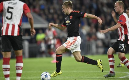 Manchester's Luke Shaw (C) vies with PSV Eindhovens midfielder Jorrit Hendrix (R) during the UEFA Champions League Group B football match between PSV Eindhoven and Manchester United at the Philips stadium in Eindhoven, Belgium on September 15, 2015. AFP PHOTO / JOHN THYS (Photo credit should read JOHN THYS/AFP/Getty Images)