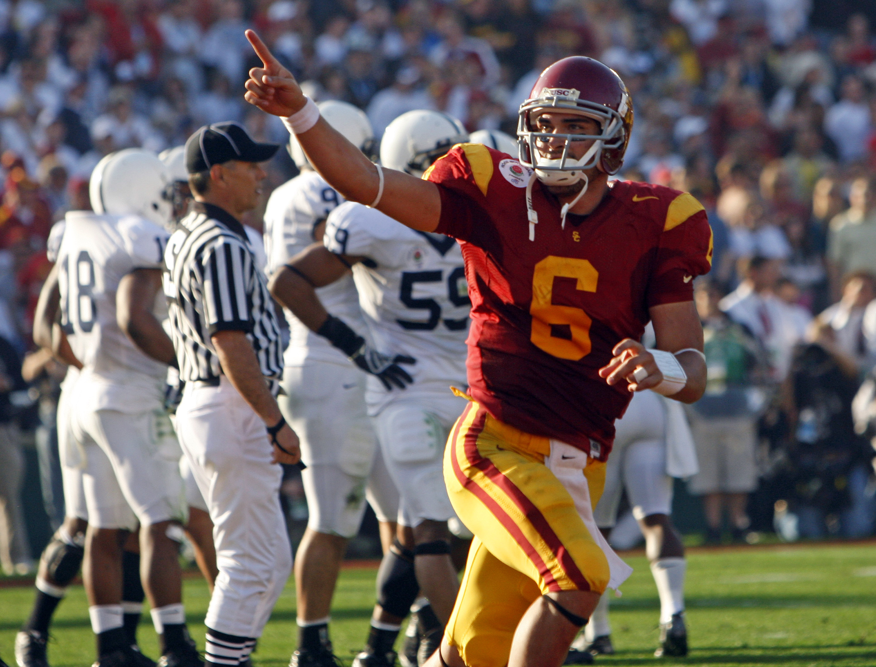 Pasadena, California–– USC Trojans quarterback Mark Sanchez signals to the crowd after his second quarter touchdown against the Penn State Nittany Lions in the 95th Rose Bowl Game in Pasadena, California January 1, 2009. (Photo by Luis Sinco/Los Angeles Times via Getty Images)
