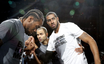 SAN ANTONIO,TX - FEBRUARY 3: Kawhi Leonard #2 of the San Antonio Spurs,Tony Parker #9 of the San Antonio Spurs and LaMarcus Aldridge #12 of the San Antonio Spurs huddle before their game against the New Orleans Pelicans at AT&T Center on February 3, 2016 in San Antonio, Texas. NOTE TO USER: User expressly acknowledges and agrees that , by downloading and or using this photograph, User is consenting to the terms and conditions of the Getty Images License Agreement. (Photo by Ronald Cortes/Getty Images)
