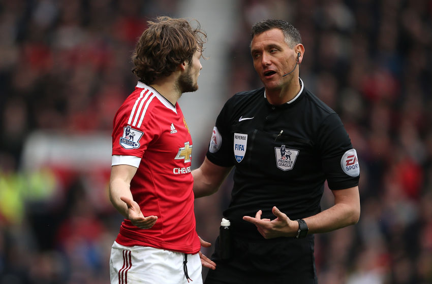 MANCHESTER, ENGLAND - APRIL 03: Daley Blind of Manchester United and Referee Andre Marriner exchange words during the Barclays Premier League match between Manchester United and Everton at Old Trafford on April 3, 2016 in Manchester, England. (Photo by Matthew Ashton - AMA/Getty Images)
