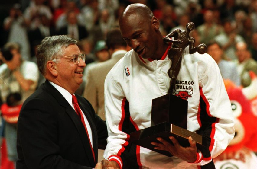 21 May 1996: Guard Michael Jordan of the Chicago Bulls shakes hands with NBA Commissioner David Stern as he is presented with the 1996 NBA Most Valuable Player award prior to the start of game two in the NBA Eastern Conference Finals against the Orlando