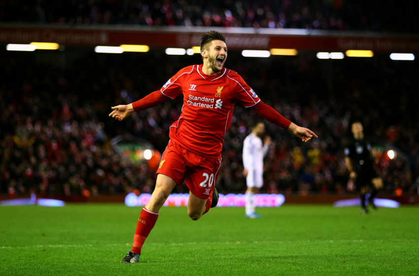LIVERPOOL, ENGLAND - DECEMBER 29: Adam Lallana of Liverpool celebrates after scoring his team's second goal during the Barclays Premier League match between Liverpool and Swansea City at Anfield on December 29, 2014 in Liverpool, England. (Photo by Clive Brunskill/Getty Images)