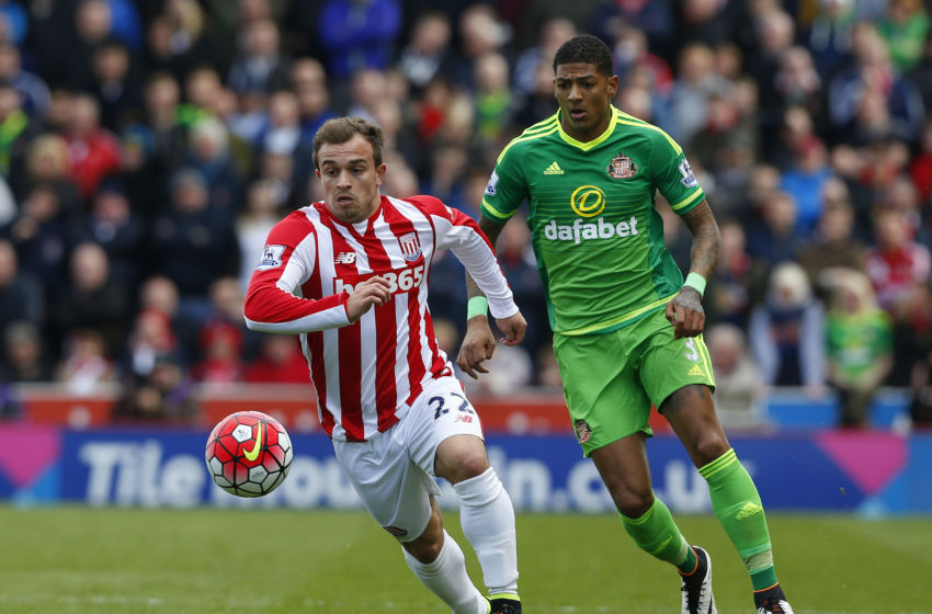 Stoke City's Swiss midfielder Xherdan Shaqiri (L) runs ahead of Sunderland's Dutch defender Patrick van Aanholt (R) during the English Premier League football match between Stoke City and Sunderland at the Britannia Stadium in Stoke-on-Trent, central England on April 30, 2016. / AFP / LINDSEY PARNABY / RESTRICTED TO EDITORIAL USE. No use with unauthorized audio, video, data, fixture lists, club/league logos or 'live' services. Online in-match use limited to 75 images, no video emulation. No use in betting, games or single club/league/player publications. / (Photo credit should read LINDSEY PARNABY/AFP/Getty Images)