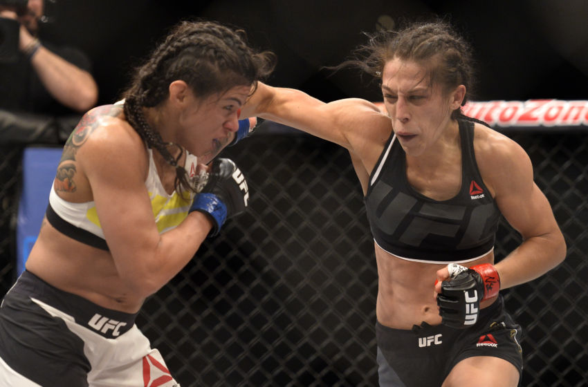 LAS VEGAS, NV - JULY 08: (R-L) Joanna Jedrzejczyk of Poland punches Claudia Gadelha of Brazil in their women's strawweight championship bout during The Ultimate Fighter Finale event at MGM Grand Garden Arena on July 8, 2016 in Las Vegas, Nevada. (Photo by Brandon Magnus/Zuffa LLC/Zuffa LLC via Getty Images)