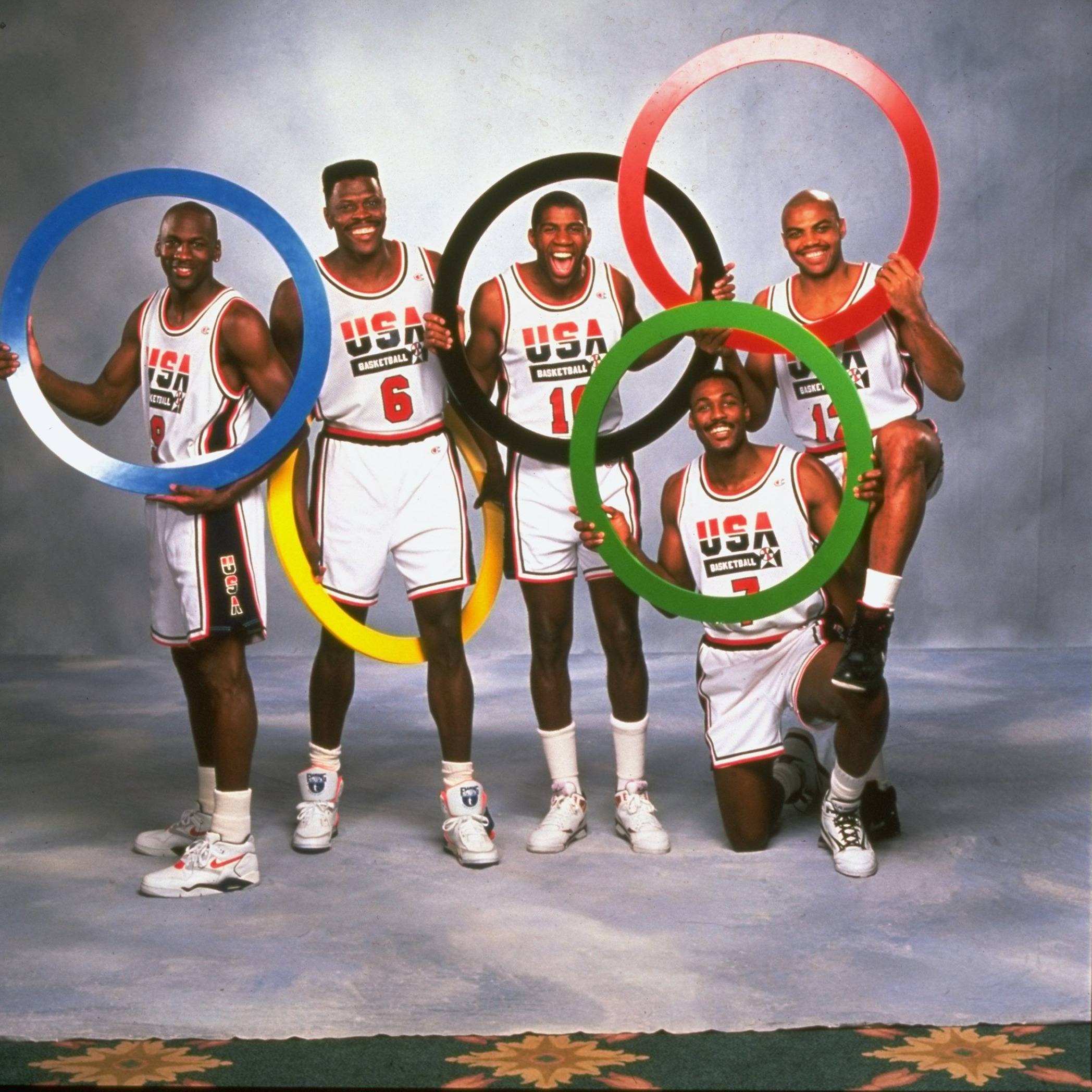 UNITED STATES - FEBRUARY 08: Basketball: Summer Games Preview, Portrait of Team USA (L-R) Michael Jordan (9), Patrick Ewing (6), Magic Johnson (10), Karl Malone (7), and Charles Barkley (12) with olympic rings, Charlotte, NC 2/8/1991 (Photo by Theo Westenberger/Sports Illustrated/Getty Images) (SetNumber: X40993)