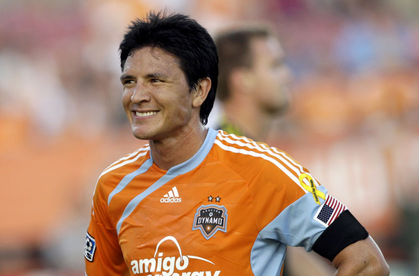 HOUSTON - JULY 10: Forward Brian Ching #25 of the Houston Dynamo smiles after missing a goal at close range on a put back in the second half against the Columbus Crew at Robertson Stadium at on July 10, 2010 in Houston, Texas. (Photo by Bob Levey/Getty Images)