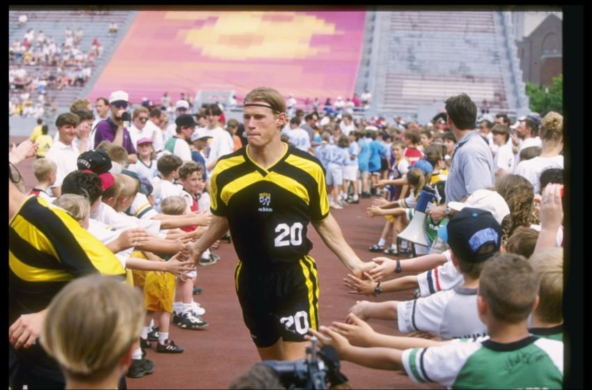 19 May 1996: Brian McBride of the Columbus Crew high fives the fan as he walks off the field after a game against the Colorado Rapids at Ohio Stadium in Columbus, Ohio. The Rapids won the game 4-2. Mandatory Credit: Rick Stewart /Allsport
