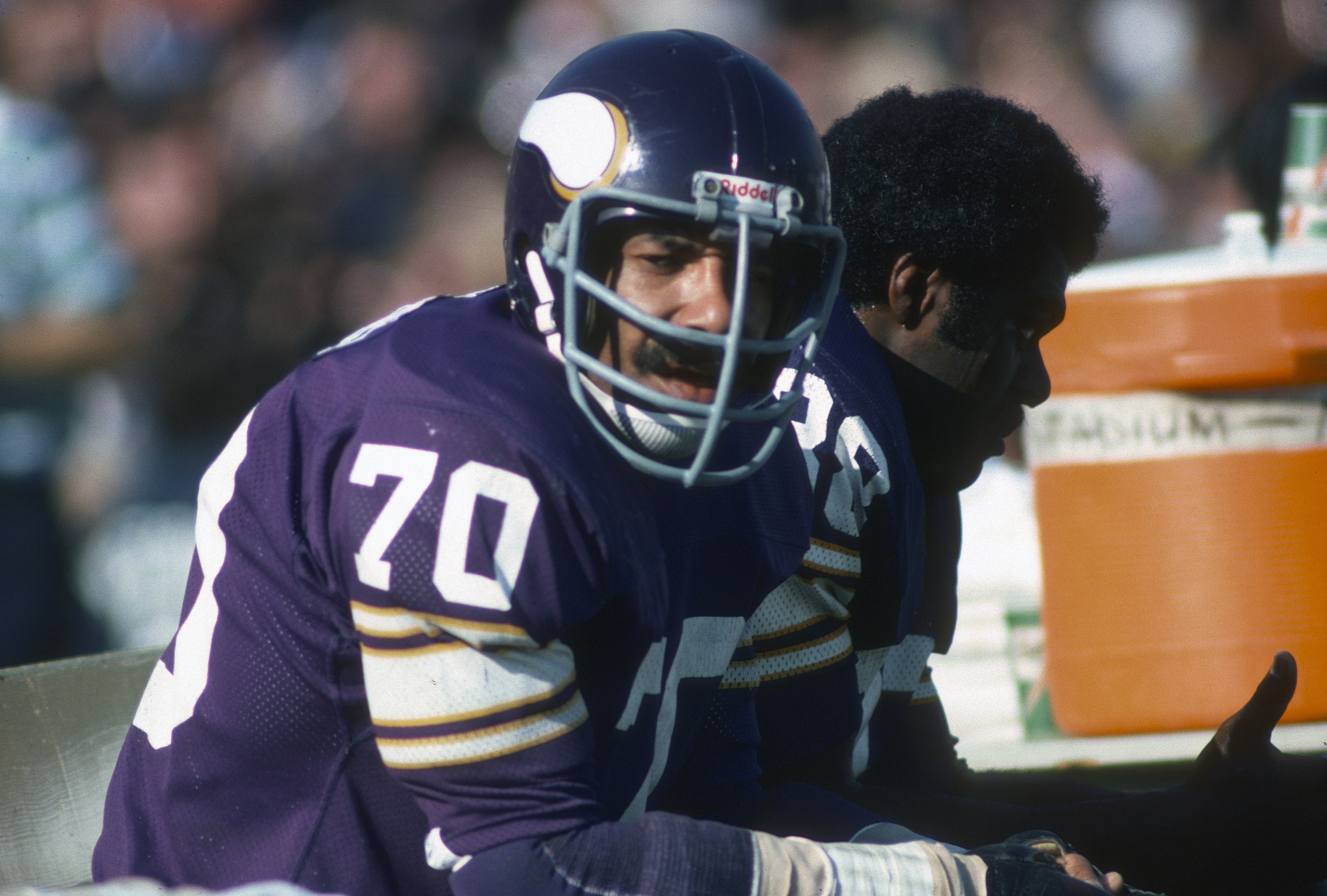 PASADENA, CA- JANUARY 9: Jim Marshall #70 of the Minnesota Vikings looks on from the bench against the Oakland Raiders during Super Bowl XI on January 9, 1977 at the Rose Bowl in Pasadena, California. The Raiders won the Super Bowl 32 -14. (Photo by Focus on Sport/Getty Images)