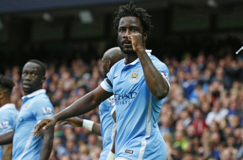 Manchester City's Ivorian striker Wilfried Bony (L) celebrates scoring their second goal during the English Premier League football match between Manchester City and Bournemouth at the Etihad Stadium in Manchester, northwest England, on October 17, 2015. AFP PHOTO / LINDSEY PARNABY RESTRICTED TO EDITORIAL USE. No use with unauthorized audio, video, data, fixture lists, club/league logos or 'live' services. Online in-match use limited to 75 images, no video emulation. No use in betting, games or single club/league/player publications (Photo credit should read LINDSEY PARNABY/AFP/Getty Images)