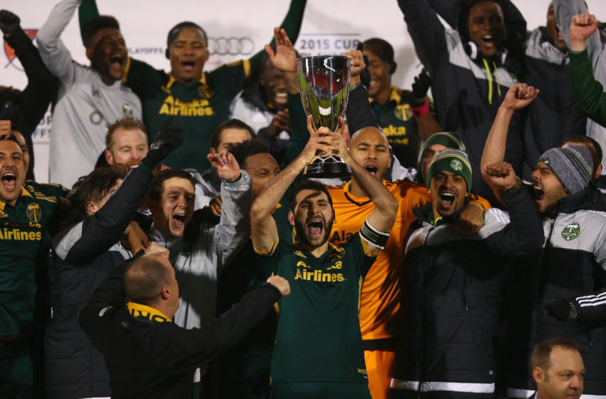 FRISCO, TX - NOVEMBER 29: Diego Valeri #8 of Portland Timbers raises the MLS Western Conference trophy after defeating FC Dallas in the Western Conference Finals-Leg 2 of the MLS playoffs at Toyota Stadium on November 29, 2015 in Frisco, Texas. (Photo by Ronald Martinez/Getty Images)