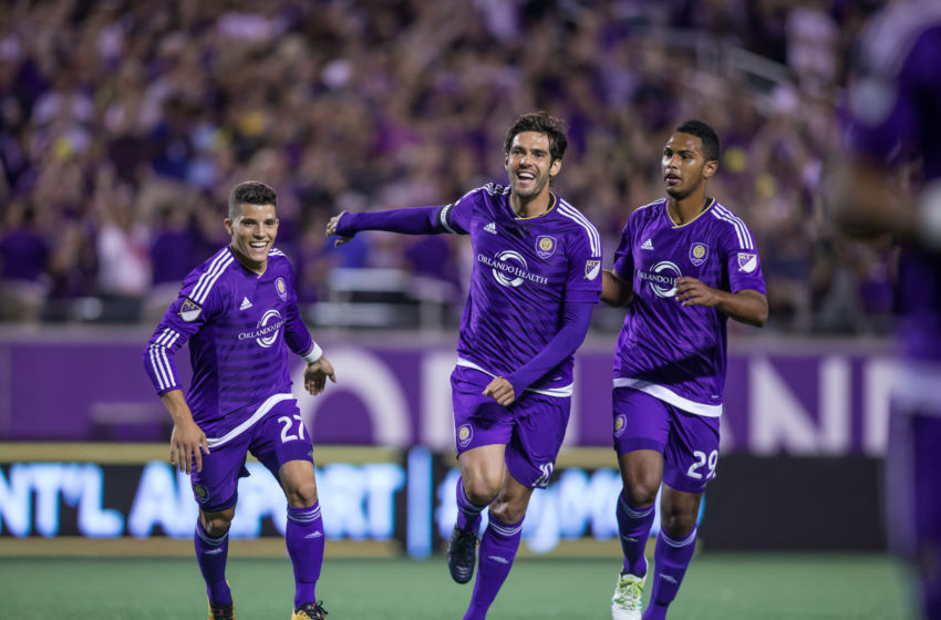 ORLANDO, FL - APRIL 3: Kaka #10, Rafael Ramos #27, and Tommy Redding #29 of Orlando City SC celebrate after the opening goal against the Portland Timbers at the Citrus Bowl on April 3, 2016 in Orlando, Florida. (Photo by Chris McEniry/Overflow Productions, Inc./Getty Images)