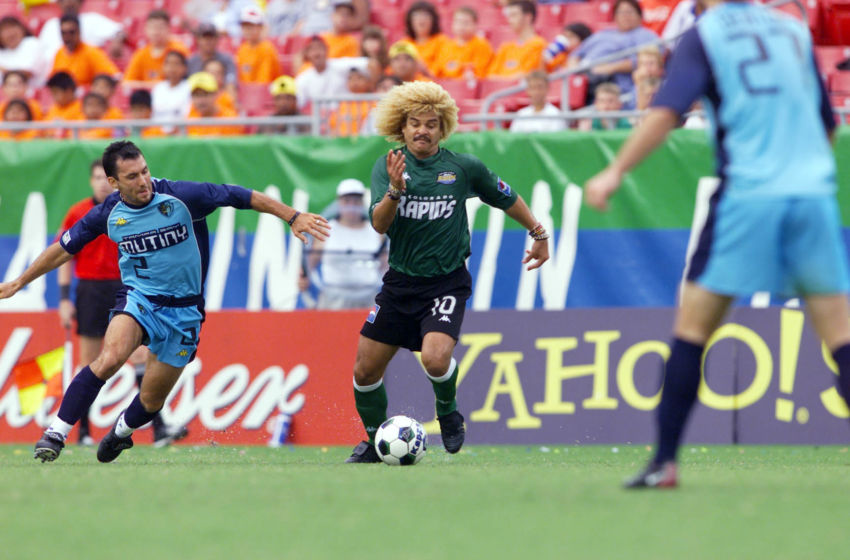 21 Jul 2001: Carlos Valderrama #10 of the Colorado Rapids dribbles against the defense of the Tampa Bay Mutiny at Raymond James Stadium in Tampa, Florida. The Rapids won 2-1 over the Mutiny. DIGITAL IMAGE. Mandatory Credit: Andy Lyons/ALLSPORT