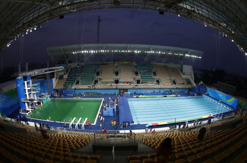 Why did the olympic diving pool water turn green for Pool expo show