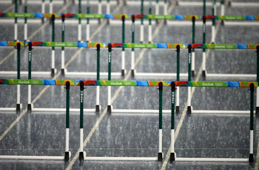 Rio Olympics track floods prior to 110m hurdles, Monday ...
