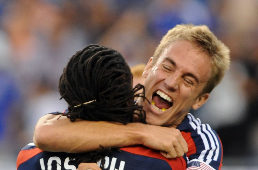 FOXBOROUGH, MA - JUNE 7: Taylor Twellman #20 of the New England Revolution celebrates his 100th career goal with Shalrie Joseph #21 during match against the New York Red Bulls June 7, 2009 at Gillette Stadium in Foxborough, Massachusetts. (Photo by Keith Nordstrom/MLS via Getty Images)