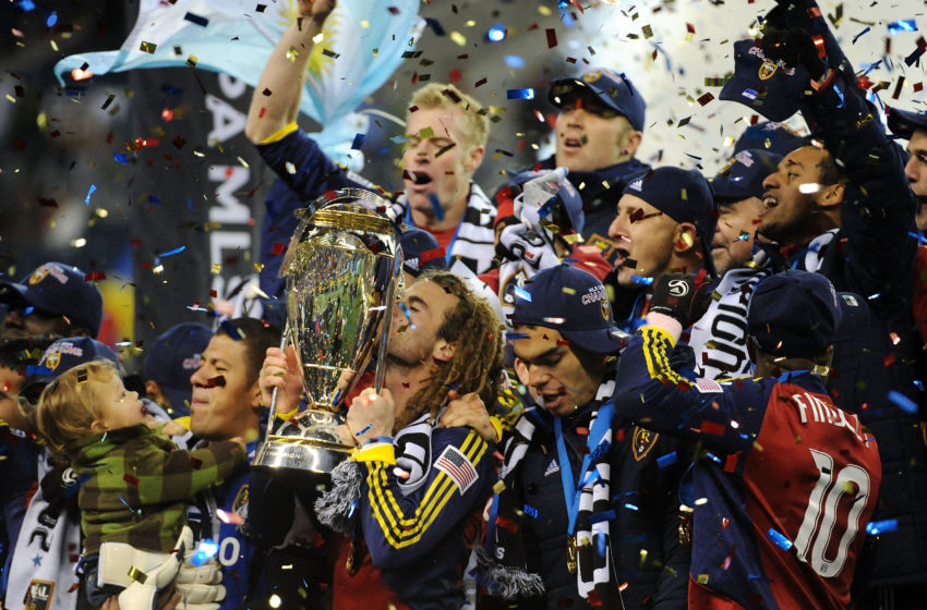 SEATTLE - NOVEMBER 22: Kyle Beckerman #5 of Real Salt Lake kisses the The Philip F. Anschutz MLS Cup trophy as he and his teammates celebrate their win over the Los Angeles Galaxy in the MLS Cup final at Qwest Field on November 22, 2009 in Seattle, Washington. Real Salt Lake won 5-4 in a penalty shootout following regulation time. (Photo by Harry How/Getty Images)