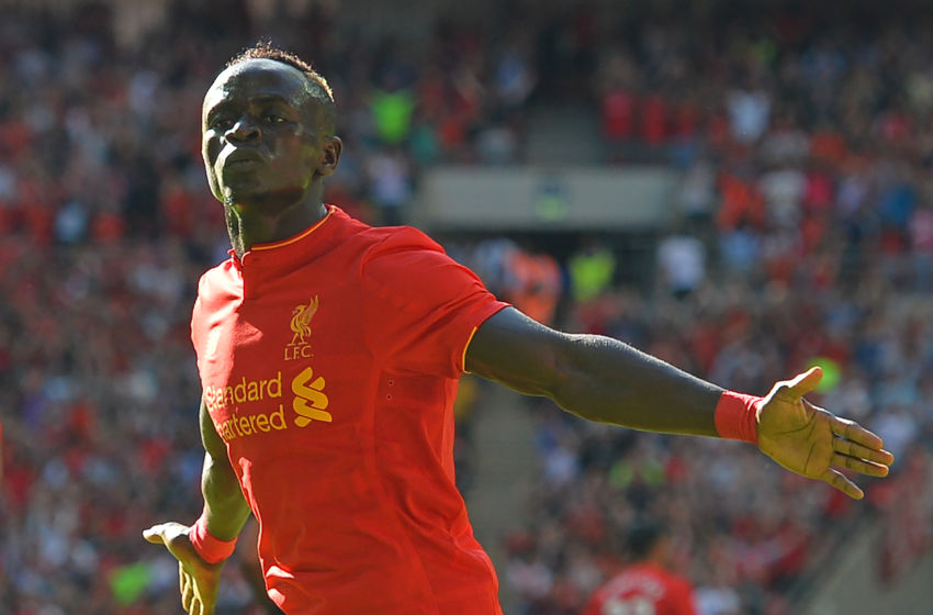 Liverpool's Senegalese midfielder Sadio Mane celebrates after scoring the opening goal of the pre-season International Champions Cup football match between Spanish champions, Barcelona and Liverpool at Wembley stadium in London on August 6, 2016. / AFP / Glyn KIRK (Photo credit should read GLYN KIRK/AFP/Getty Images)