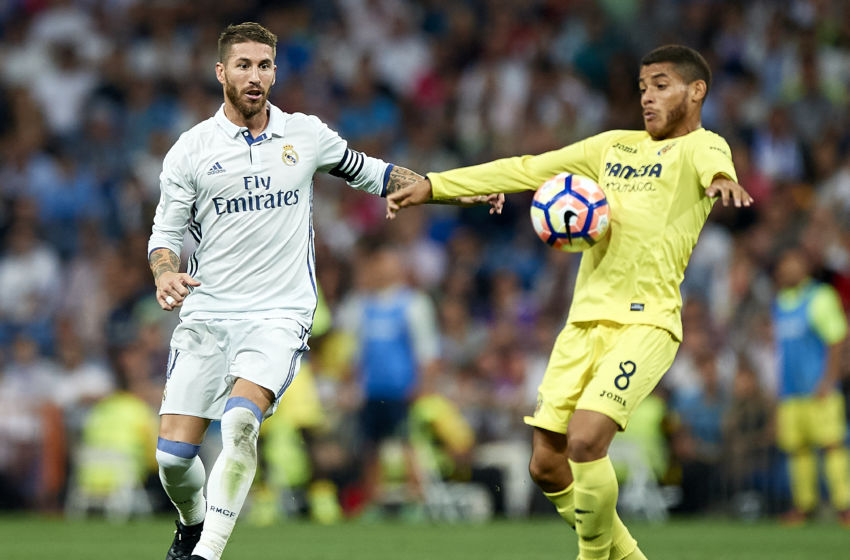 MADRID, SPAIN - SEPTEMBER 21: Sergio Ramos of Real Madrid competes for the ball with Jonathan Dos Santos (R) of Villarreal during the La Liga match between Real Madrid CF and Villarreal CF at Estadio Santiago Bernabeu on September 21, 2016 in Madrid, Spain. (Photo by fotopress/Getty Images)