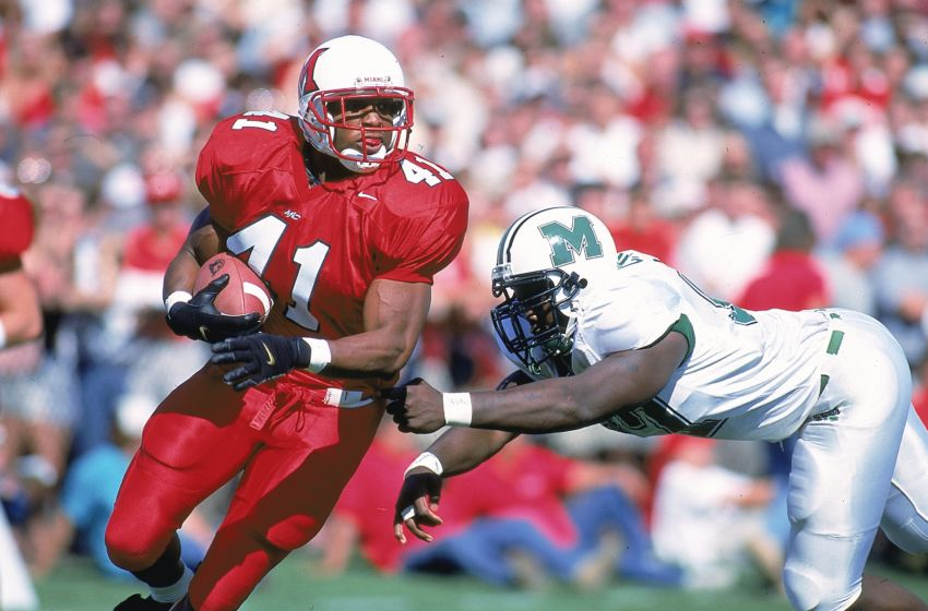2 Oct 1999: Travis Prentice #41 of the Miami (OH) Redhawks moves with the ball as Carlos Smith #97 of the Marshall Thundering Herd tries to takle him during the game at Yager Stadium in Oxford, Ohio. The Thundering Herd defeated the Redhawks 32-14. Mandatory Credit: Jonathan Daniel /Allsport